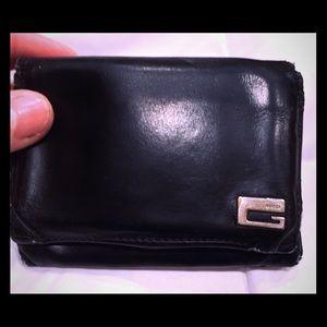 Men's Gucci black leather wallet.
